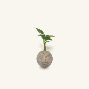 Metis concrete and lava-rock sphere planter grey with gold by Dirty Roots